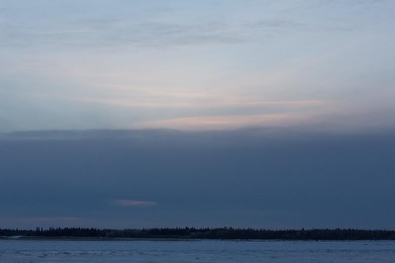 Dull skies around sunrise at Moosonee.