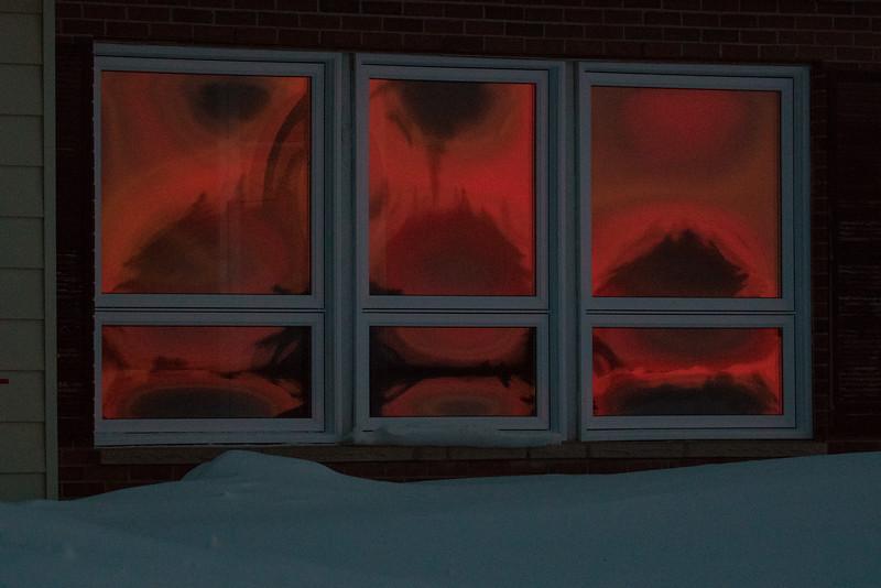 Pre sunrise sky reflected in windows of MNR staff house in Moosonee.
