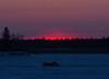 Sky near the south end of Butler Island just before sunrise across from Moosonee. Dump truck on winter road.