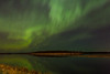 Aurora Borealis or Northern Lights over Moosonee and the Moose River. Ring patterns in centre of image.