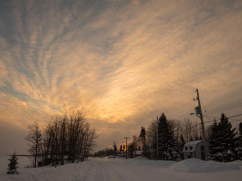 Cloudy skies at sunset in Moosonee. Spiralling clouds.