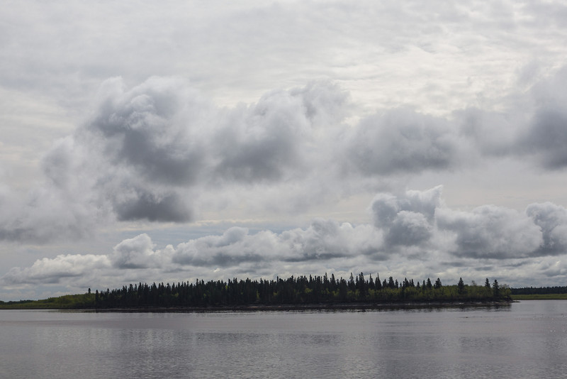 Clouds over Butler Island in the Moose River.