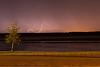 Lighting across the Moose River from Moosonee.