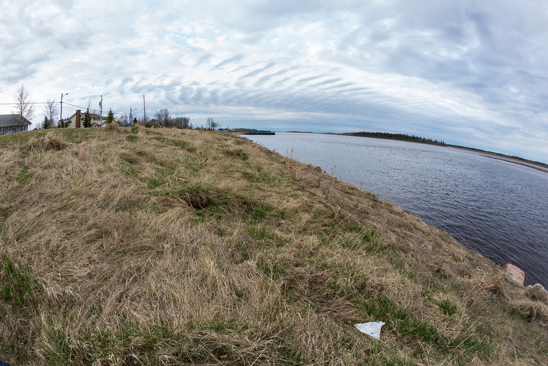 Long clouds over the Moose River at Moosonee.