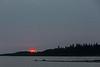 Sunrise at Moosonee. Reddish sun.