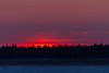 Sunrise across the Moose River from Moosonee.