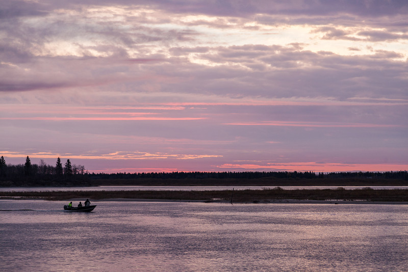 Clouds over the Moose River just before sunrise. Canoe in foreground.