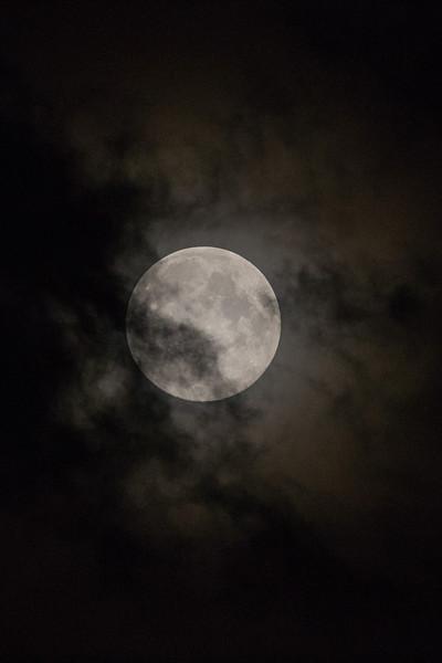 Full moon over Moosonee through the clouds (blue moon).
