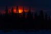 Sunrise over Butler Island in the Moose River across from Moosonee, Ontario.