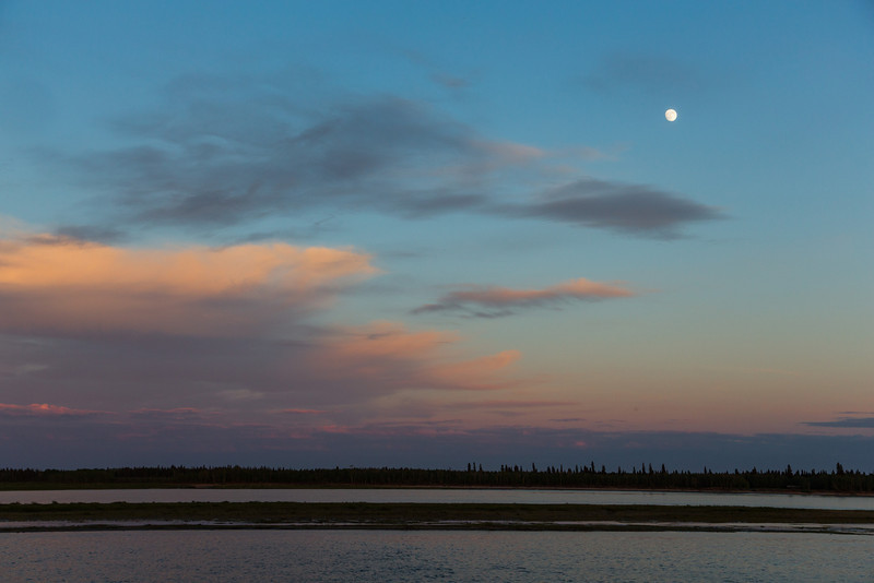 Moon over clouds over the Moose River.