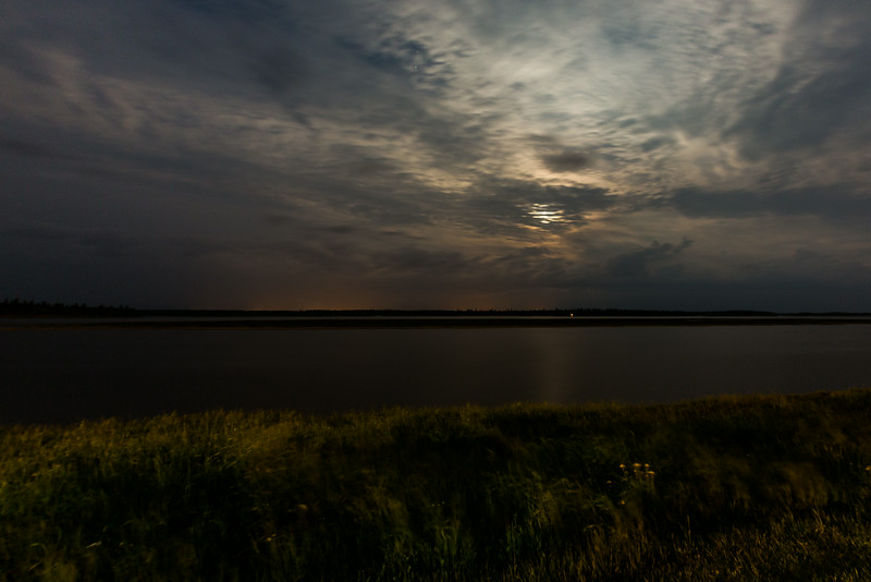 Night time views of clouds over the Moose River from Moosonee.