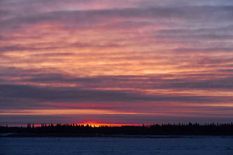 Sky just before sunrise looking across the Moose River from Moosonee. Coloured clouds.