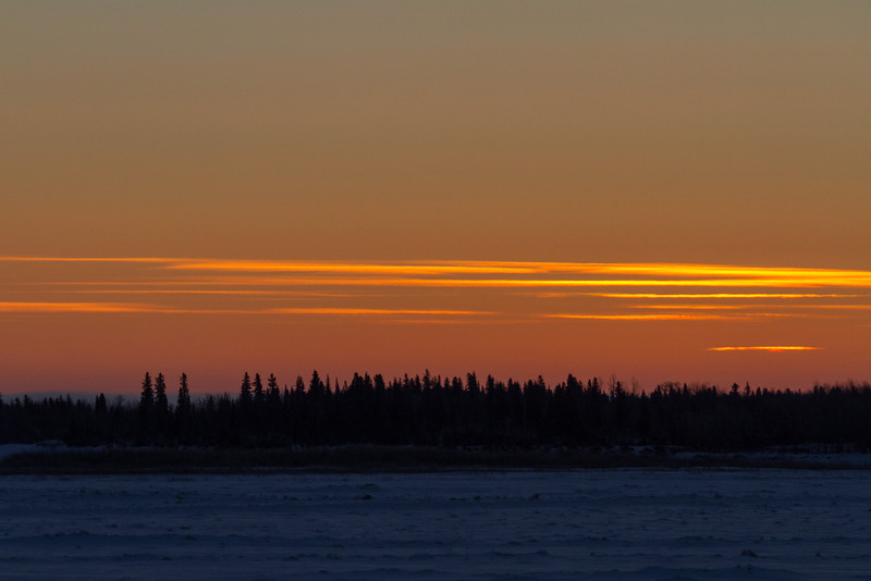 Sky before sunrise; very bright area just above the horizon.