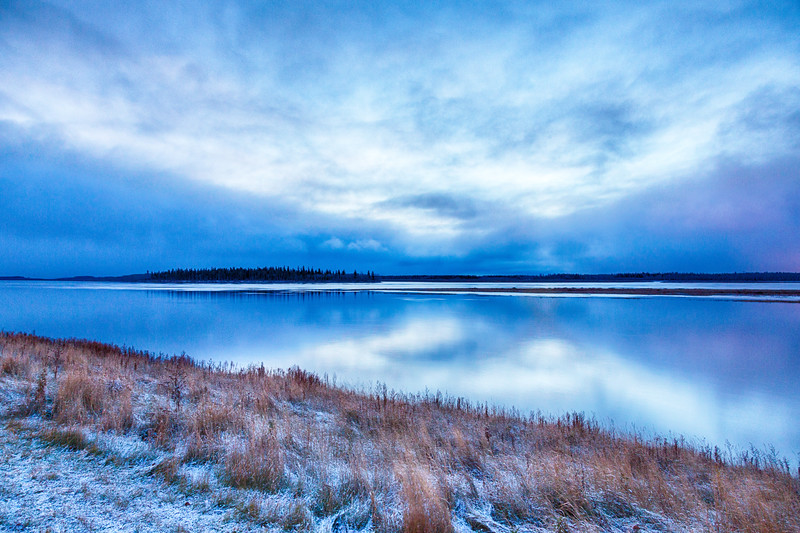 Little colour except blue in the sky over the Moose River at Moosonee before sunrise. Snow on the ground. HDR Efx.