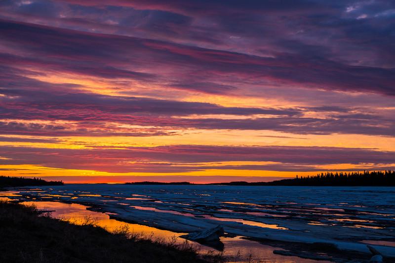 Looking down the Moose River at Moosonee at sunrise. No breakup but water higher.