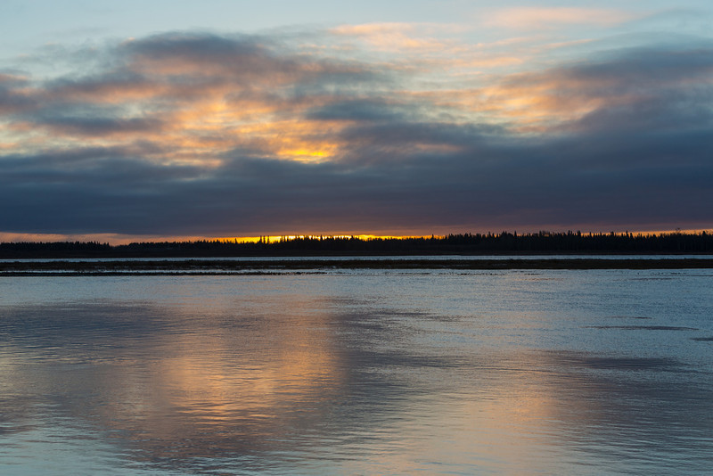 Clouds after sunrise with reflections in the Moose River.