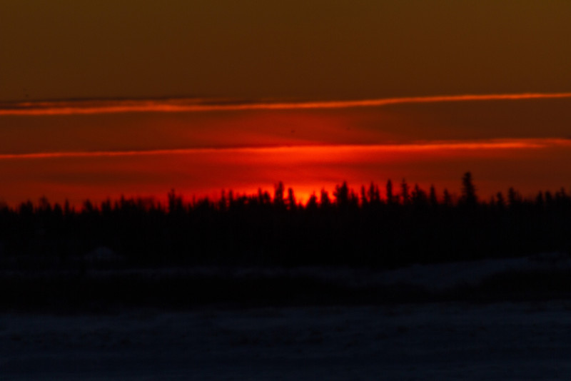 Looking across the Moose River from Moosonee around sunrise. Darker exposure as sun starts to appear.