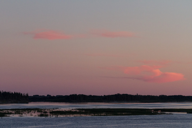 Coloured clouds around sunset looking up the Moose River from Moosonee.
