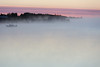 Looking down the Moose River around sunrise on a foggy morning. Canoe and barges.