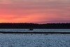 Hospital boat heading to Moose Factory from Moosonee before sunrise on the Moose River.