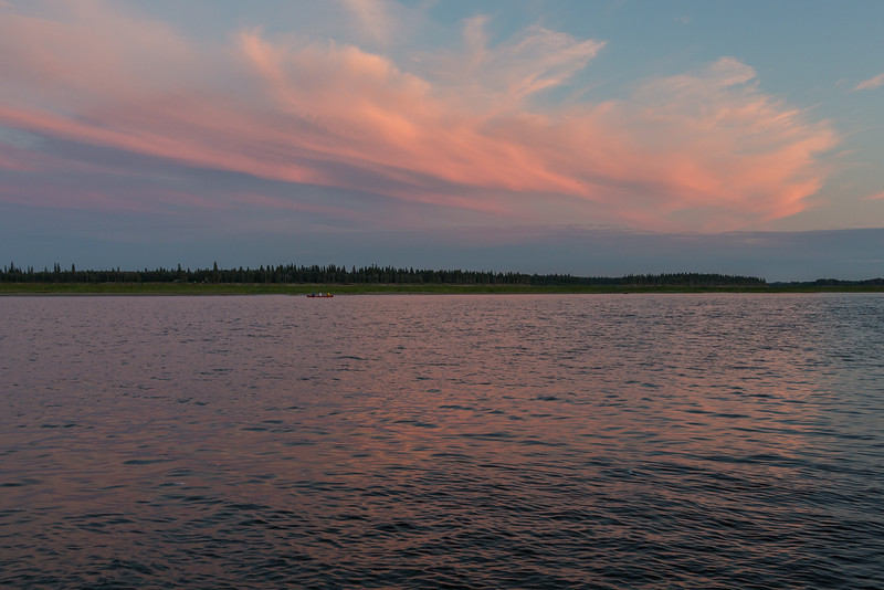Clouds over Charles Island in the Moose River at Moosonee reflected in the water.