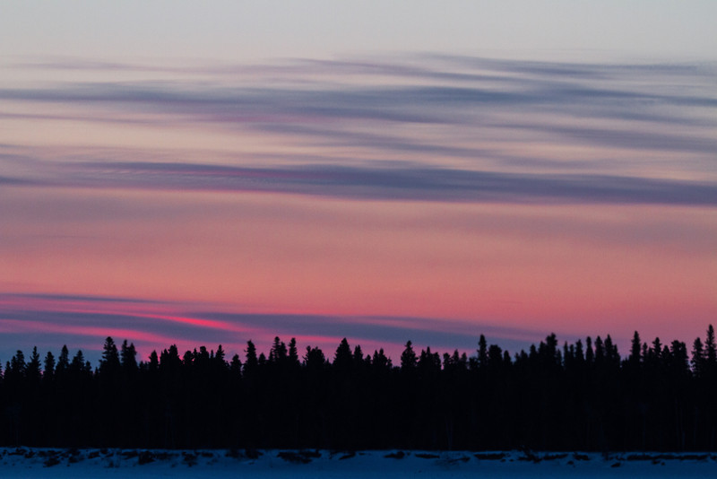 Sky before sunrise over Butler Island in the Moose River at Moosonee, Ontario.