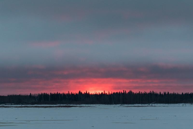 Sunrise at Moosonee looking across the Moose River.
