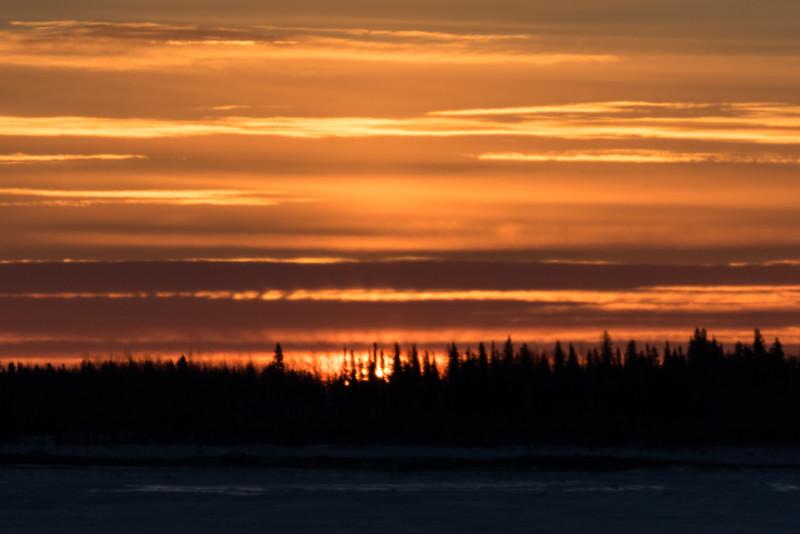 Looking across the Moose River from Moosonee at sunrise.