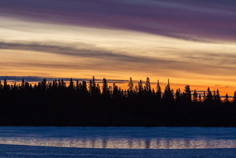 Light skies under clouds over Butler Island before sunrise.