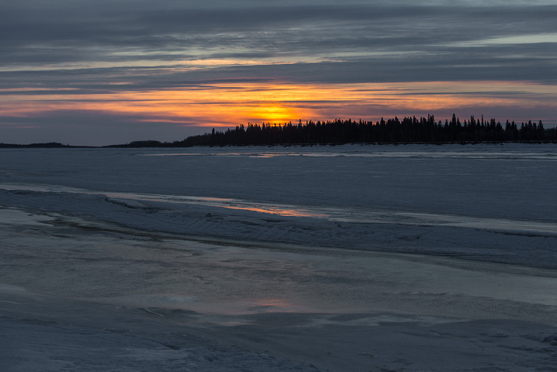 Looking across the ice of the Moose River towards Butler Island before sunrise.