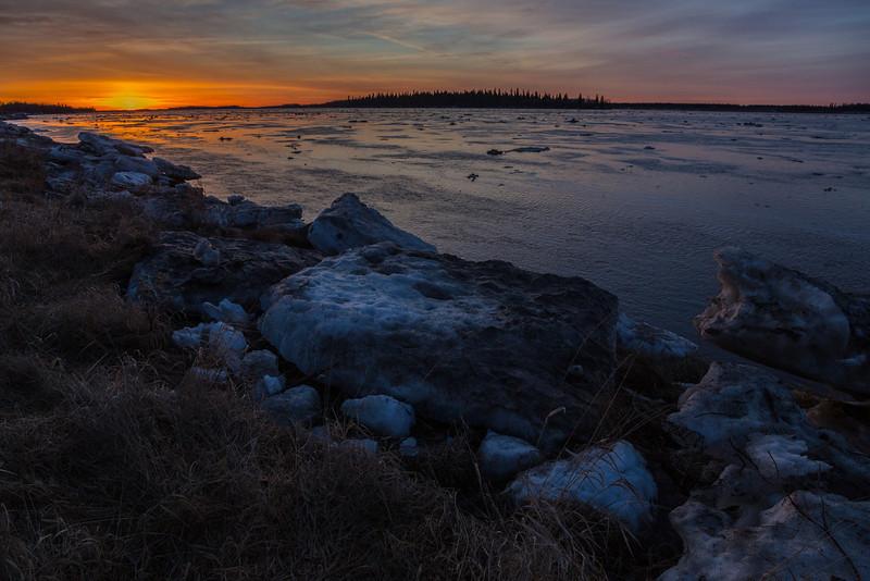 Moose River sunrise. Ice floating down river.