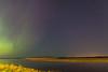 Moose River at Moosonee with aurora borealis.