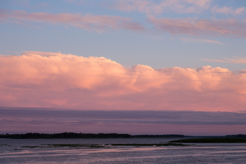 Looking up the Moose River at Moosonee towards hydro towers before sunset.