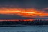 Sky at sunrise across the Moose River from Moosonee HDR dark.