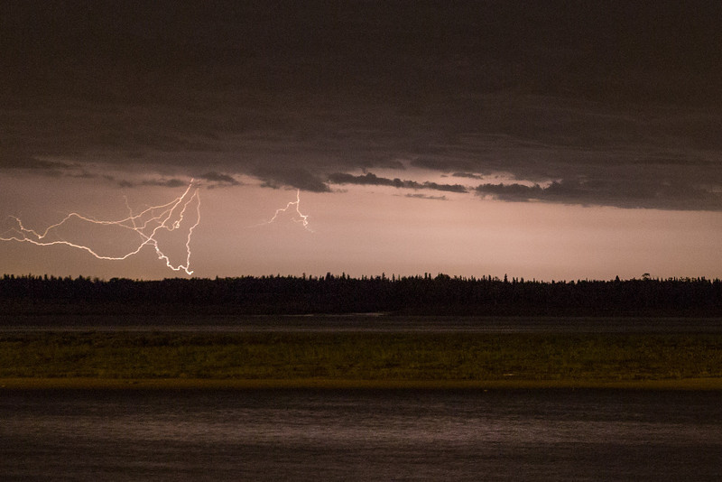 Night time storms across the Moose River from Moosonee.