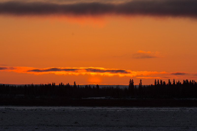 Sky before sunrise above Moose Factrory Island across the Moose River from Moosonee.