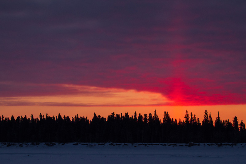 Sky before sunrise over Butler Island in the Moose River across from Moosonee.