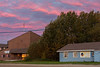 Colourful skies over Moosonee before sunrise. Government building and Keewaytinok Native Legal Services.