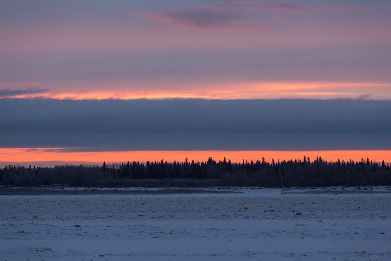 Sky before sunrise, looking across the Moose River from Moosonee.