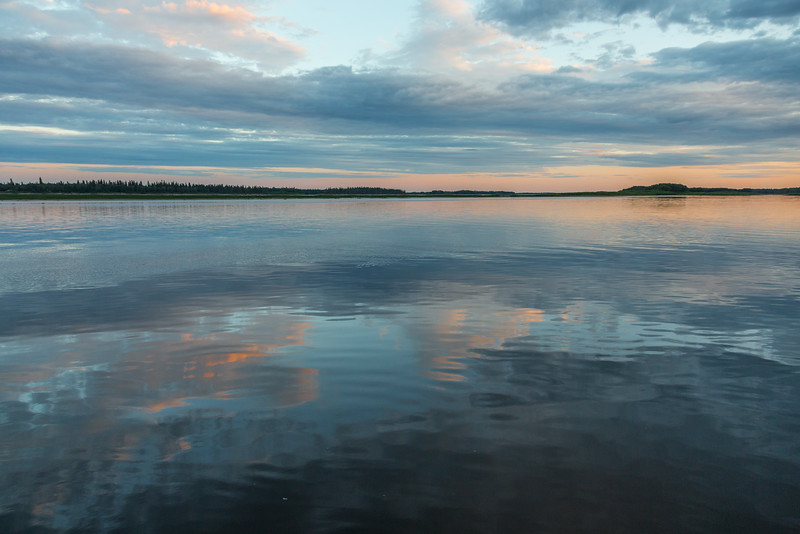 Reflection of clouds in the Moose River at Moosonee.