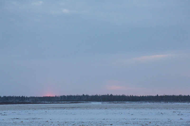 Cloudy sunrise above Moose Factory Island across the Moose River from Moosonee.