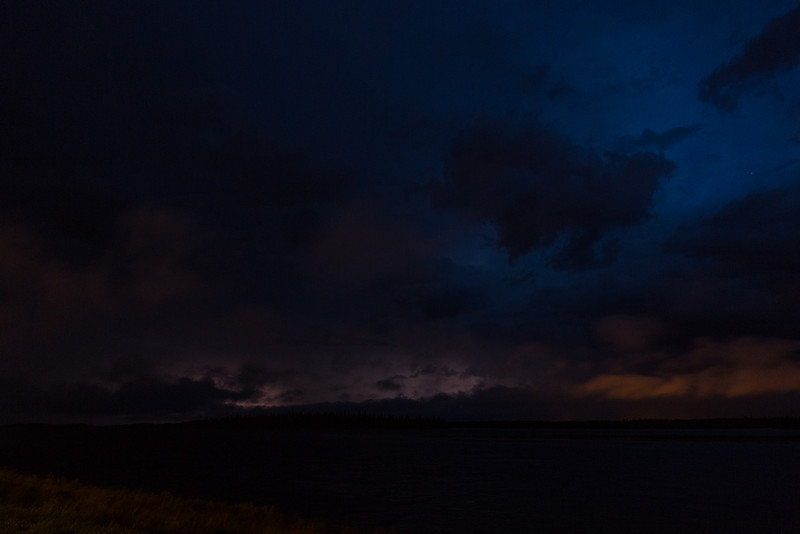 Lightning over the Moose River. Reddish light at right is from Moose Factory.