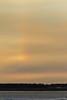 Hint of a rainbow in the sky near the sun.