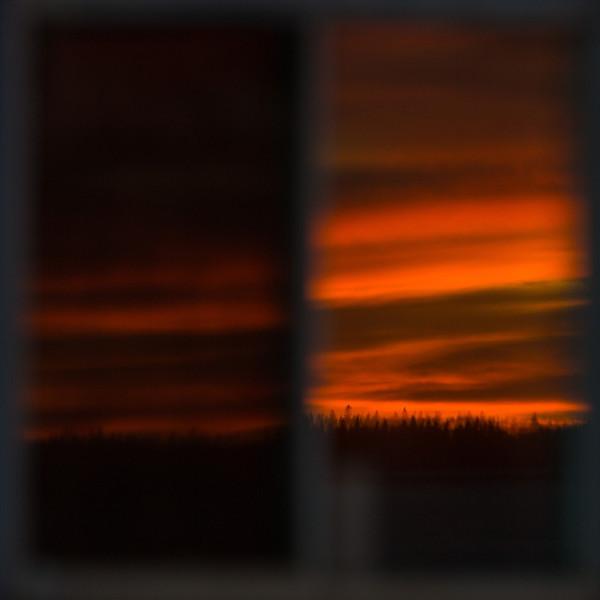 Sky before sunrise in office bathroom window.