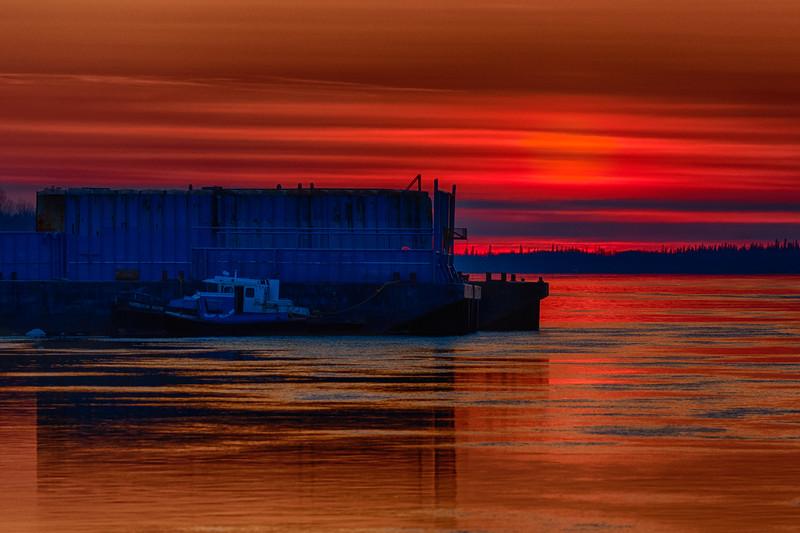 Shortly before sunrise barges anchored at Moosonee. HDR efx dark.
