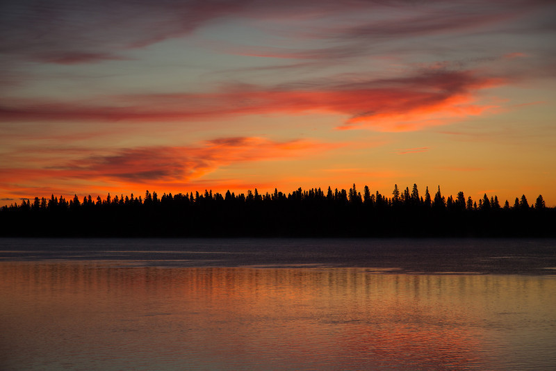 Butler Island, across the Moose River from Moosonee, before sunrise. Coloured clouds reflected in the water.