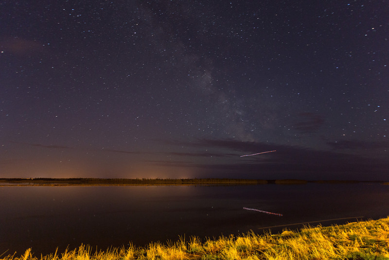 Night sky over Moose Factory from Moosonee. Aircraft flying south from Moosonee turning over the Moose River.