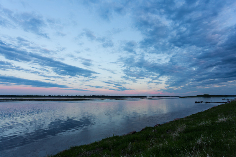Clouds over the Moose River around sunset. Looking up the river.