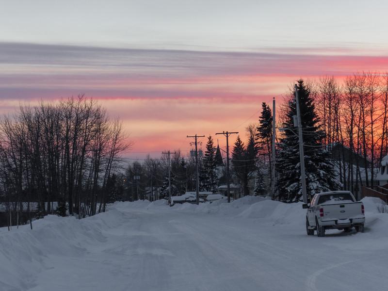 Sunset skies looking up Revillon Road in Moosonee.