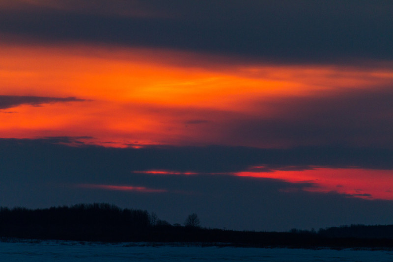 Cloudy sunrise looking down the Moose River from Moosonee.
